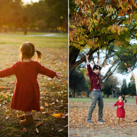 Toddler girl facing the sunset in red dress throwing autumn leaves in Rancho Cordova park Sacramento