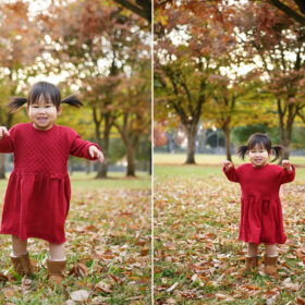 Toddler girl wearing red dress and pigtails dancing on fall leaves on the ground in Sacramento Rancho Cordova