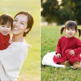 Mom smiling and holding daughter on grass at Rancho Cordova park Sacramento
