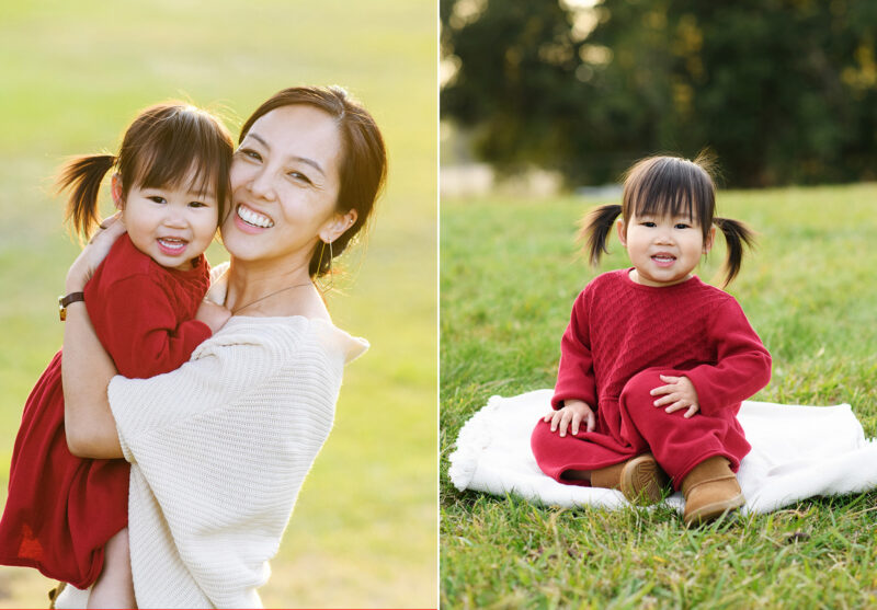 Mom smiling and holding daughter on grass at Rancho Cordova park Sacramento