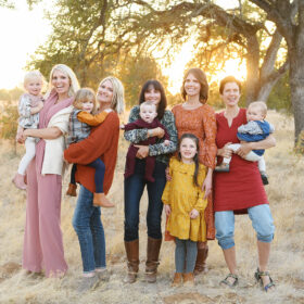 All the women and girls in the family smile for the picture during sunset in Folsom