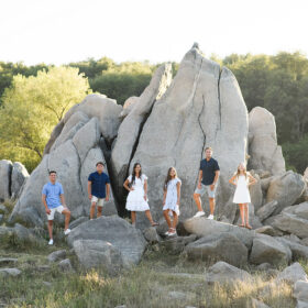 Family picture staggered against rock formation in Folsom Lake