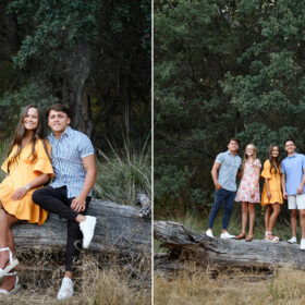 Siblings standing and sitting on fallen log surrounded by tall green trees in Folsom Lake