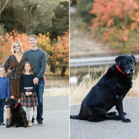 Family photo with black labrador retriever dog with fall foliage in the background