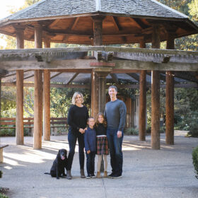 Family photo with dog under pagoda in Sacramento park