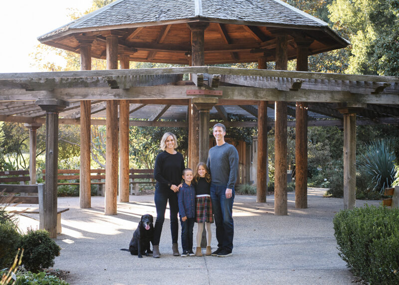 Family photo with dog under pagoda in Davis park