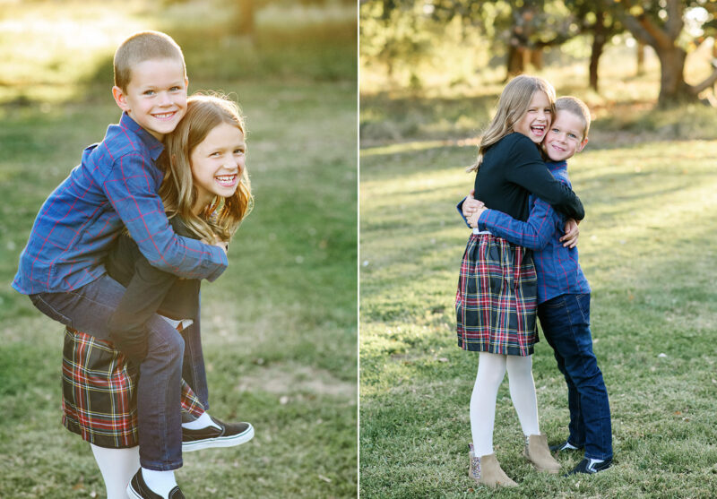 Brother and sister hugging and doing a piggyback ride in Davis park