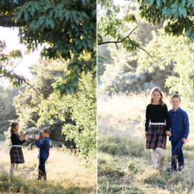 Brother and sister playing games while framed with tree branches in dry grass in Sacramento