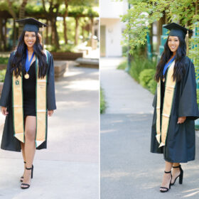 Sacramento State college graduate girl walking towards camera wearing cap and gown and smiling with trees in background