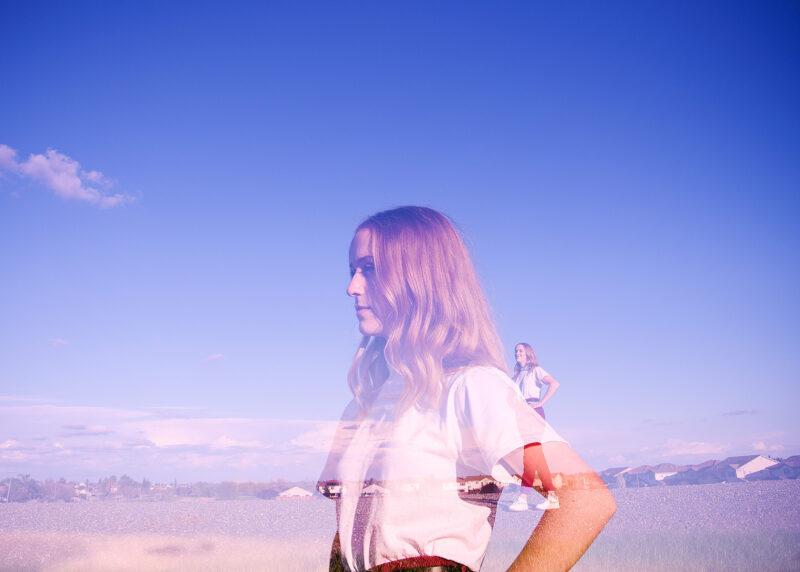 Double exposure of teen girl looking at the horizon Sacramento