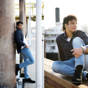 High school senior boy leaning against Sacramento waterfront pier and ferry