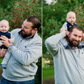 Dad holds baby son on shoulders and smiles at camera outdoors in Davis