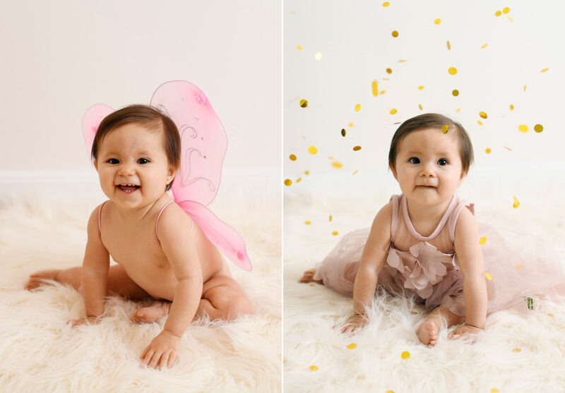 Baby girl in pink fairy wings crawls to camera. Baby girl in pink dress looks at camera while gold confetti falls in air.