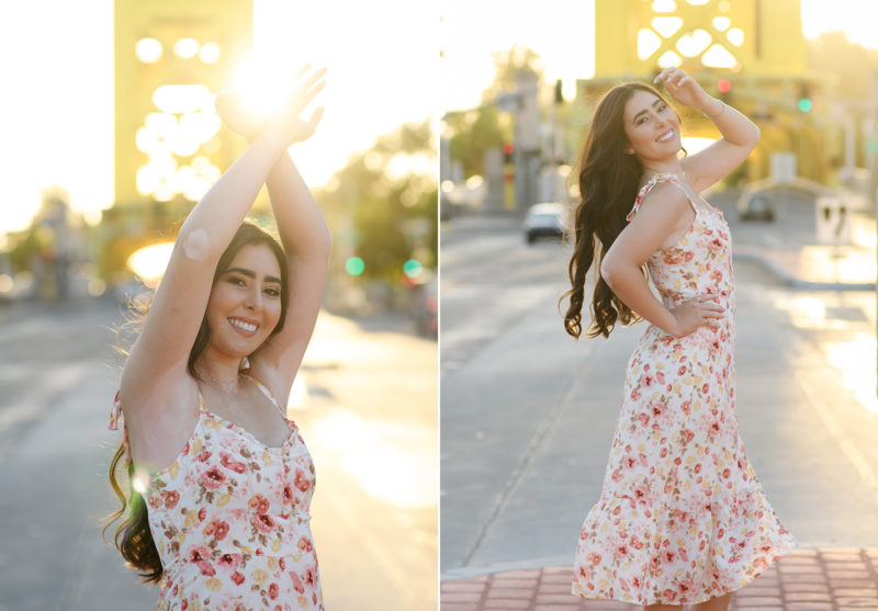 High school senior girl wearing dress and posing in front of Tower Bridge in Sacramento