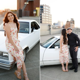 Teen girl posing with dad in white classic car on Sacramento rooftop