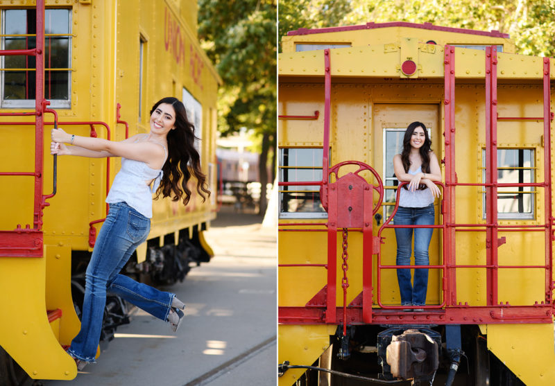 Teen girl hanging off of yellow and red train in Old Sacramento