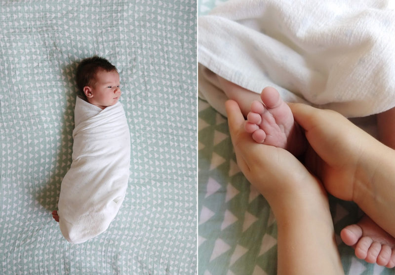 Newborn baby swaddled and lying in bed and close up of bay feet being held shot by camera phone Sacramento