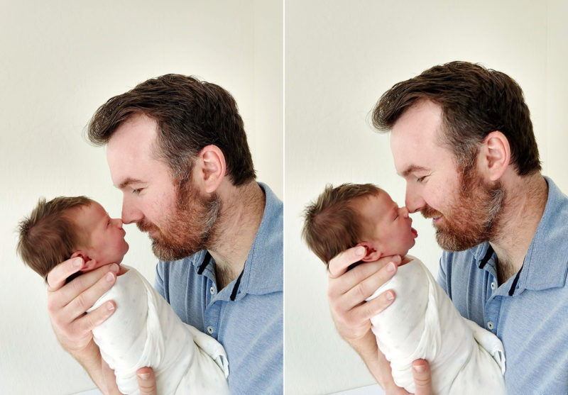Dad holding newborn nose to nose in Sacramento home shot by camera phone