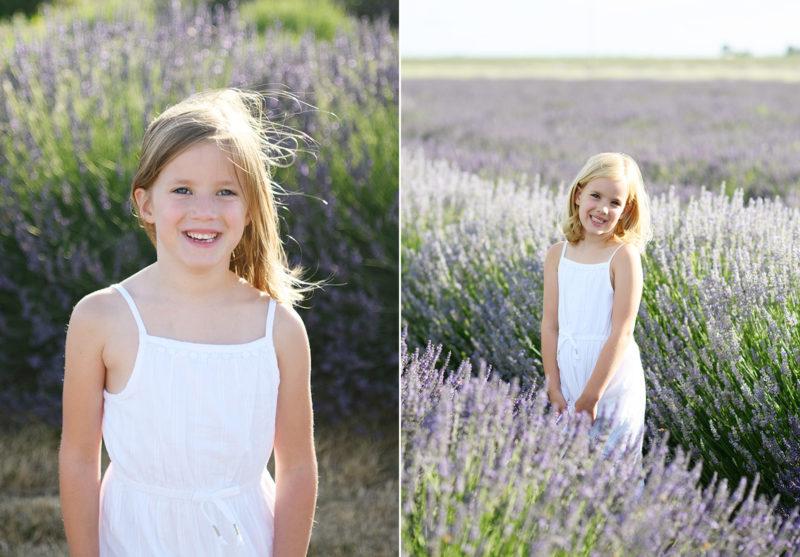 Little girls in white dresses smiling in the middle of lavender fields in Araceli Farms in Dixon