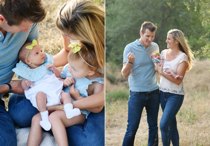 Toddler sister and newborn baby girl wear matching yellow bows while mom and dad hold them in Rocklin