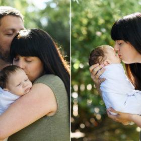 Mom kisses sleeping newborn baby in Sacramento home backyard