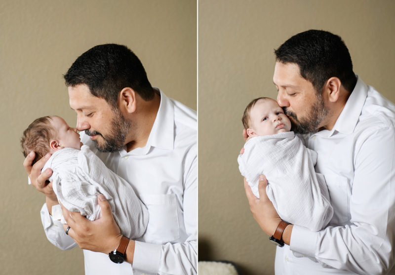 Dad kisses newborn baby boy and holds him close in Sacramento home
