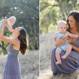 Mom lifting up baby boy and smiling at him while standing in dry grass in Davis
