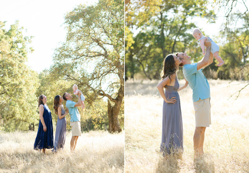 Mom, dad and grandma lift up baby boy in the air in middle of dry grass field in Roseville