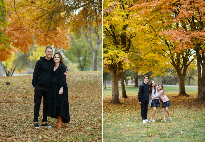 Mom and dad wearing black and hugging and kids hugging while standing on fall leaves and surrounded by foliage Sacramento