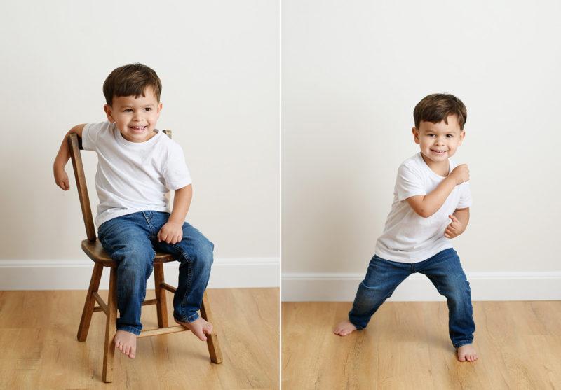Toddler boy sitting on chair and posing on hardwood floor in Sacramento studio