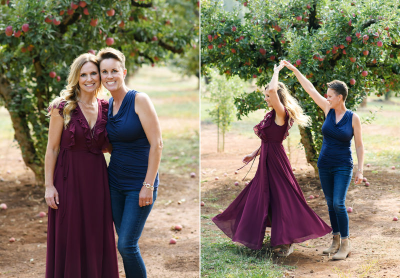 Two moms smiling and twirling for the camera in Apple Hill apple orchard