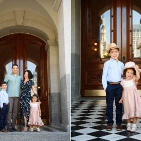 Family posing in front of Sacramento State Capitol building with kids wearing hats