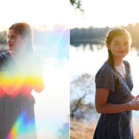 High school senior girl by Folsom lake in sunlight lens flare
