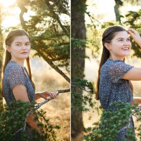 High school senior girl framed by trees and smiling in natural light Folsom