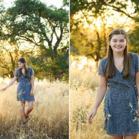 Teen girl touching dry grass field during sunset light in Folsom